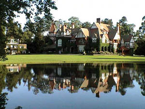 Estancia Villa Maria built in the Norman-Tudor style, complete with lake and guest house on the left.